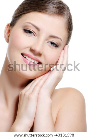 Portrait of a cheerful beauty young girl with a perfect clear skin