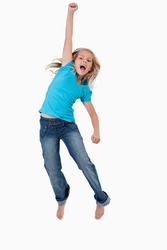 Portrait of a cheerful girl jumping against a white background