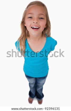 Portrait of a cheerful girl posing against a white background