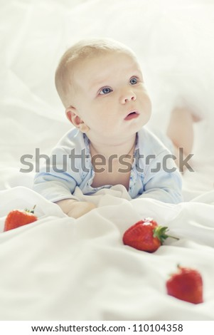 portrait of a cheerful kid with strawberries