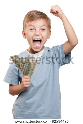Portrait of a cheerful little boy holding a dollars over white background