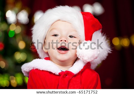 Portrait of a cheerful Santa baby - stock photo