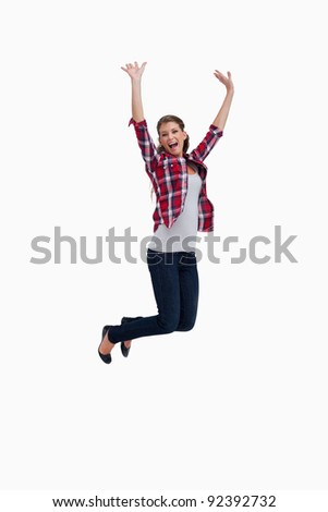 Portrait of a cheerful woman jumping against a white background