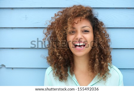 Portrait of a cheerful young african woman smiling ストックフォト ©