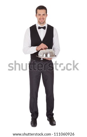 Portrait of a cheerful young butler. Isolated on white