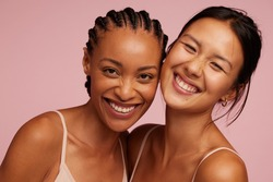 Portrait of a cheerful young women looking at camera and smiling.  Natural Beauties with fresh and clean skin