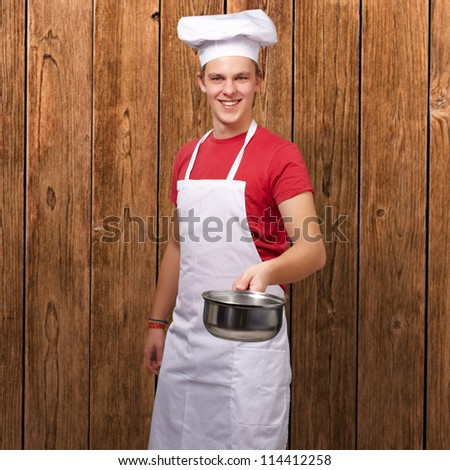 Portrait Of A Chef Holding Pan, Indoor