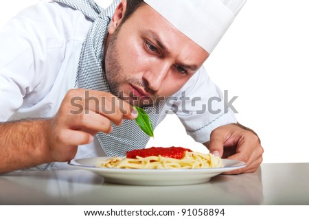 Portrait of a  chef preparing dinner isolated on white background