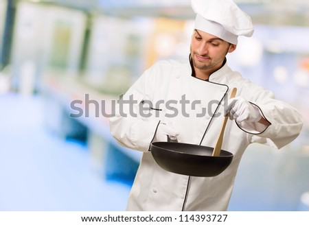 Portrait Of A Chef Preparing Food, Indoors