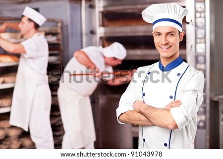Portrait of a chef standing inside a bakery