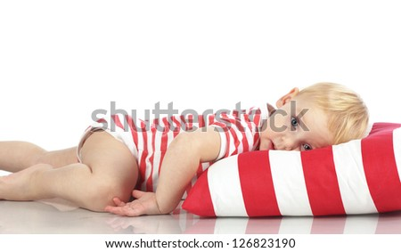 Portrait of a child lying on soft pillow studio shot