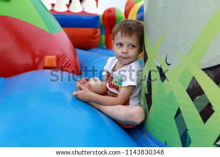 Portrait of a child on the trampoline #1143830348