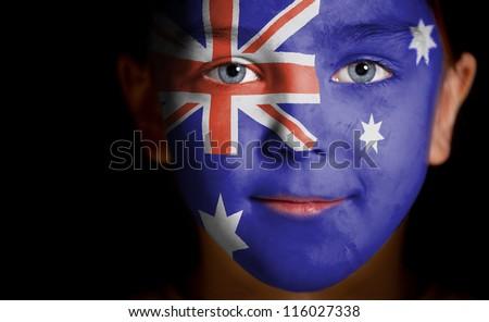 Portrait of a child with a painted Australian flag, closeup