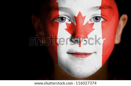 Portrait of a child with a painted Canadian flag, closeup - stock photo