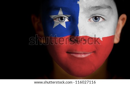 Portrait of a child with a painted Chile flag, closeup