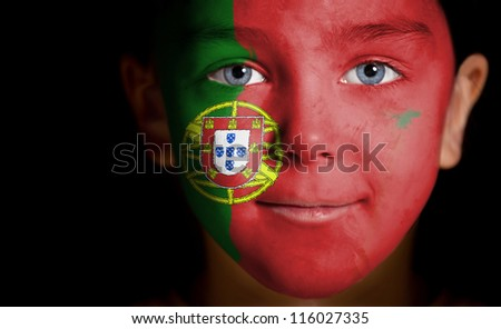 Portrait of a child with a painted Portuguese flag, closeup