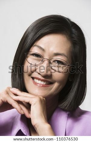 Portrait of a Chinese woman with glasses