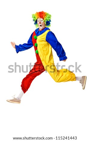 Portrait of a clown jumping over white background