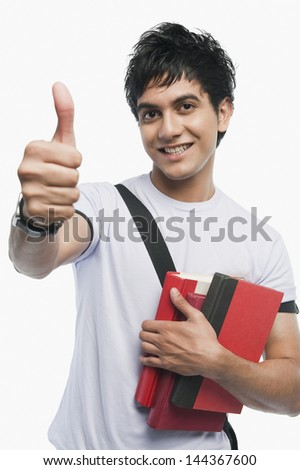 Portrait of a college student showing thumbs up