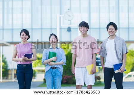 Portrait of a college student standing in the green Stock photo ©