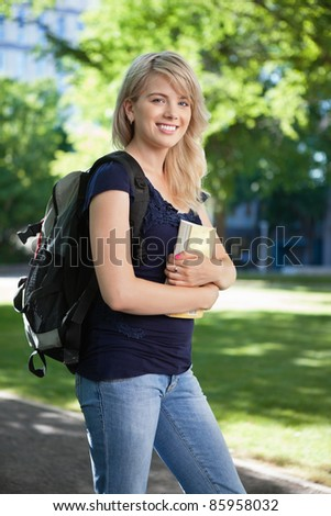 Portrait of a college student with book and bag
