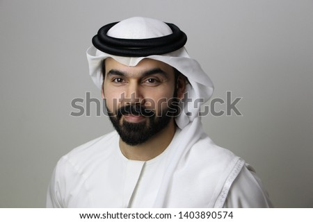 Portrait Of A Confident Arab Business Man Facing The Camera Smiling With His Eyes