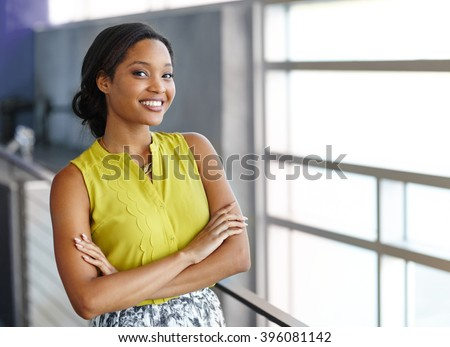 Portrait of a confident black businesswoman at work in her glass office