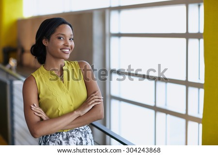 Portrait of a confident businesswoman at work in herglass office
