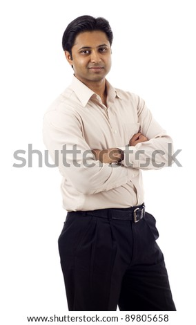 Portrait of a confident Indian business man with hands folded isolated over white background