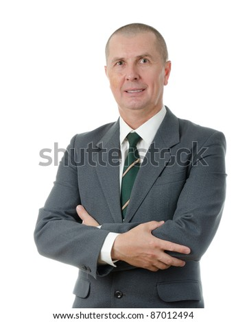 Portrait of a confident male entrepreneur standing with folded hand isolated on white background