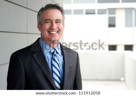 portrait of a confident mature businessman standing outside  #151912058