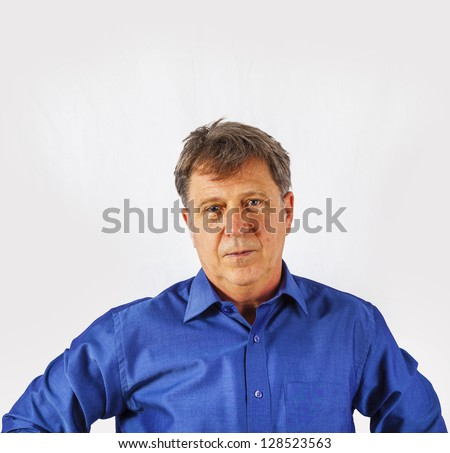 Portrait of a confident senior man standing on white background