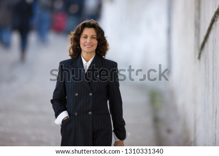 Portrait of a confident smiling business woman on a street in the city. Stock photo ©