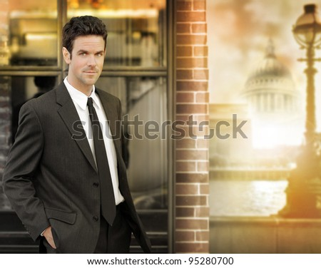 Portrait of a confident young businessman out in the city in golden light