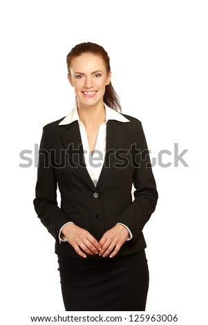 Portrait of a confident young woman standing isolated on white background.