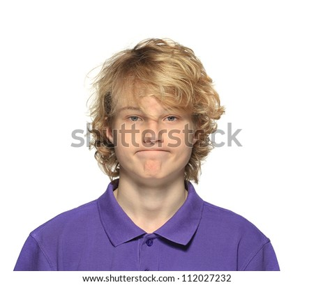Portrait of a confused teenage boy ,on a white background.