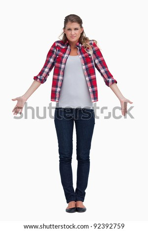 Portrait of a confused young woman against a white background