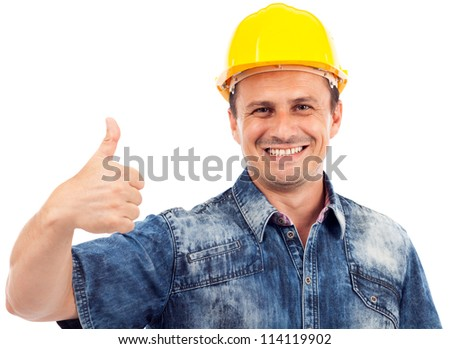 Portrait of a construction worker with hardhat making thumbs up sign - stock photo