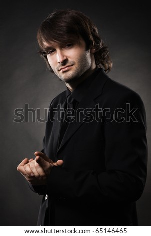 Portrait of a cool man against black background