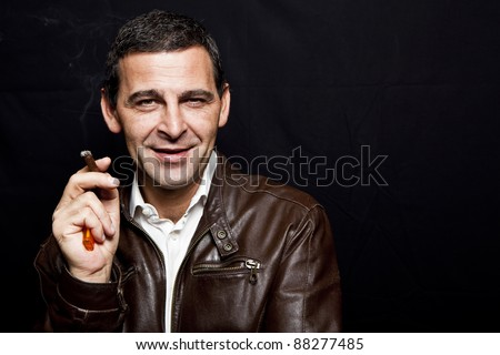 stock photo portrait of a cool mature man with leather jacket over black background 88277485 It was one of the wettest Pride parades in Dallas that I can think of.