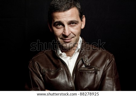stock photo portrait of a cool mature man with leather jacket over black background 88278925 XXXDessert.com   Free XXX Pics and Videos
