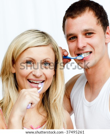 Portrait of a couple cleaning their teeth in bathroom