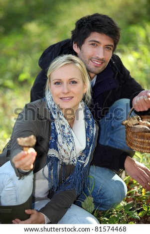 portrait of a couple collecting mushrooms