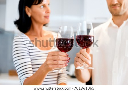 Portrait of a couple having a glass of red wine #781961365