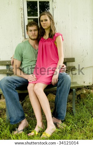 Portrait of a couple in front of an old building - stock photo
