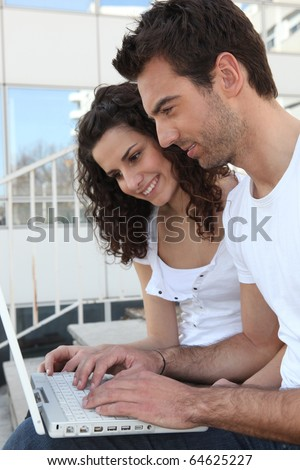 Portrait of a couple in front of laptop computer