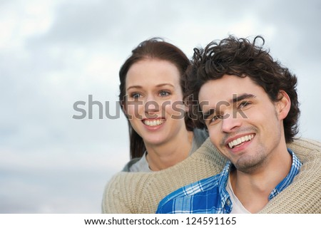 Portrait of a couple of friends smiling outdoors