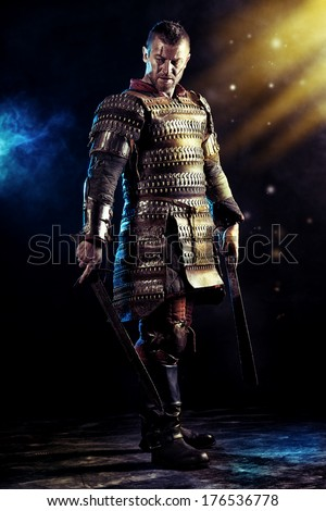 Portrait of a courageous ancient warrior in armour with sword