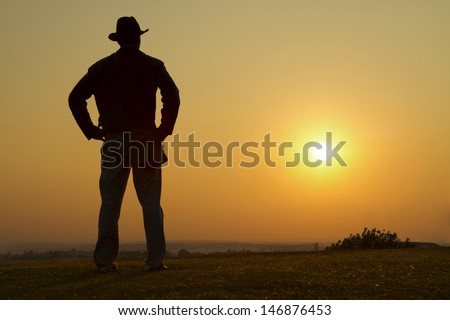 Portrait of a Cowboy Gazing into the sunset