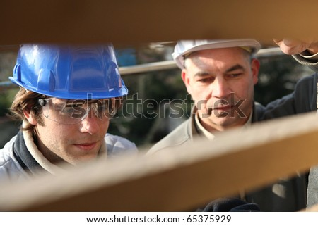 Portrait of a craftsman and an apprentice